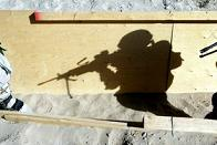 A silhouette of a soldier on patrol.